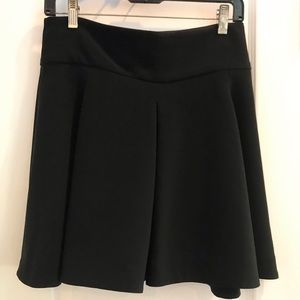 Black flared mini skirt with front pleats